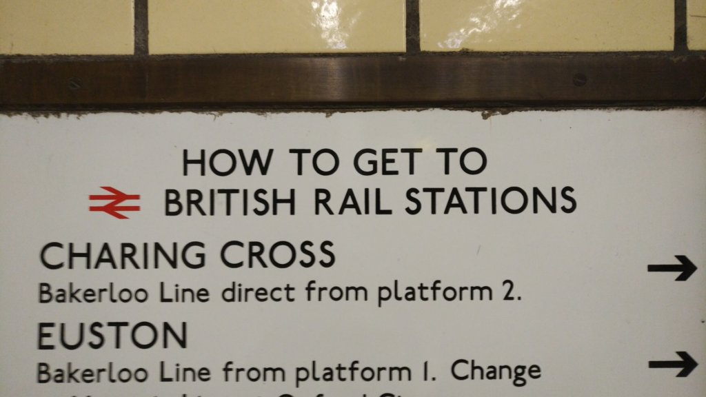 Information sign with directions to british rail stations